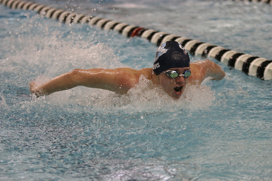 Coming up for air, junior Mason Davis swims in the EKL Finals Saturday, Feb. 8 after competing in EKL Prelims Friday, Feb. 7.
