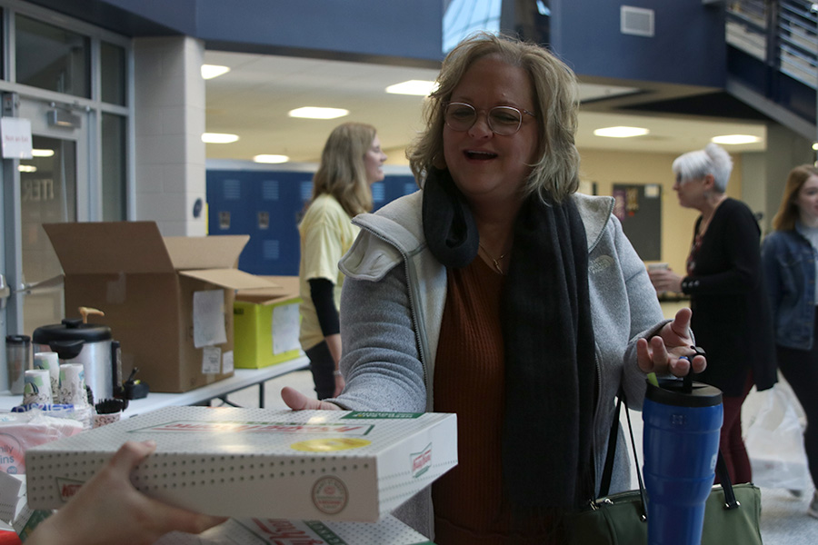Buying a dozen donuts, paraprofessional Robin Roberts helps support the Spanish NHS fundraiser held Feb. 20 and 21 to help send relief to the citizens of Puerto Rico after the earthquakes they have suffered through this year.
