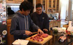 Senior cooks traditional ethnic family dishes