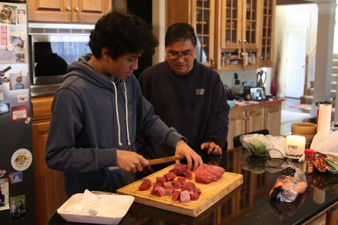 Together, senior Nico Gatapia and his father Ramulus Gatapia make Kaldereta.