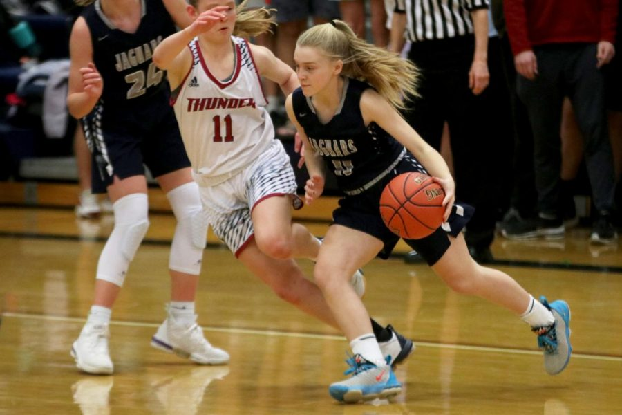 Dribbling+the+ball%2C+freshman+Sophie+Pringle+runs+past+an+opponent.+The+team+lost+to+St.+James+60-30+on+Friday%2C+Feb.+7.