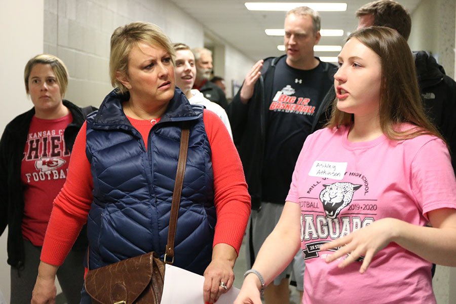 Giving+the+tour%2C+sophomore+Ashley+Atkinson+gives+incoming+freshmen+and+their+parents+a+tour+around+the+school.