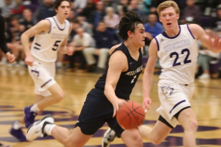 Sprinting down the field, senior Brayden Whisler, goes for the layup after stealing the ball from Blue Valley Northwest. The team fell 88-41 Tuesday, Feb. 18.