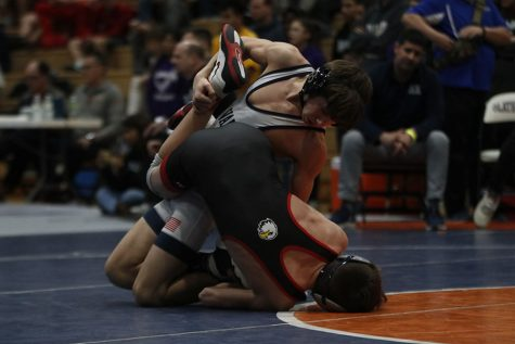 On the verge of breaking his opponent, freshman Eddie Hughart takes control of the match at regionals Saturday, Feb. 22.