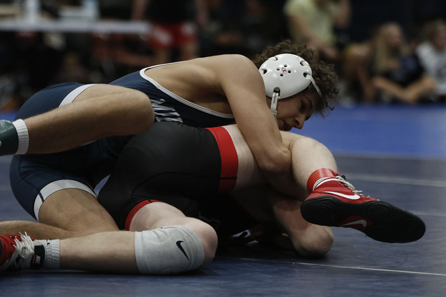 On his way to victory, senior Zach Keal maintains control of his opponent.