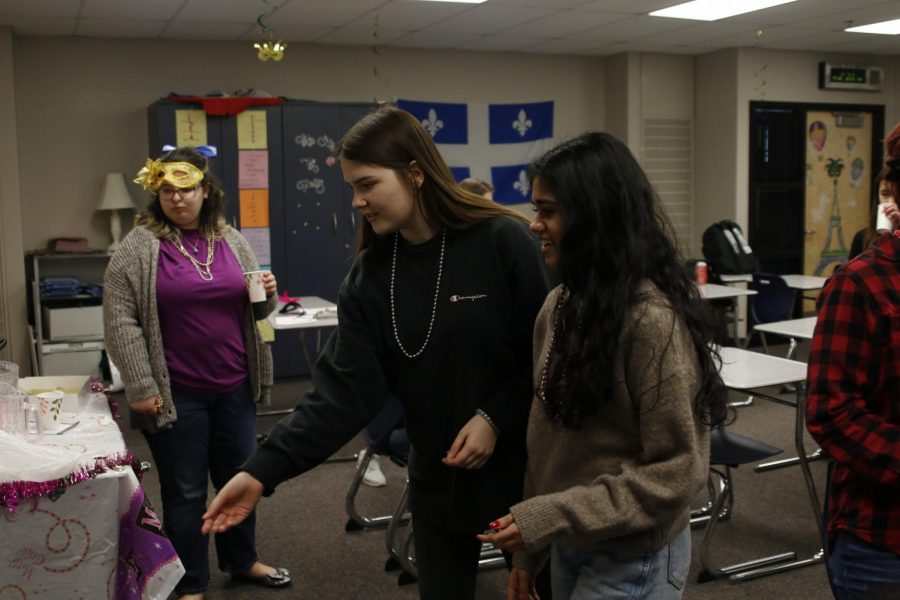 While playing a ring toss game, junior Morgan Prosser prepares to throw a ring. To celebrate Mardi Gras, french teacher Charisse Highlander's classes participated in games, music and ate the traditional Mardis Gras king cake Monday, Feb. 24 and Tuesday, Feb. 25.
