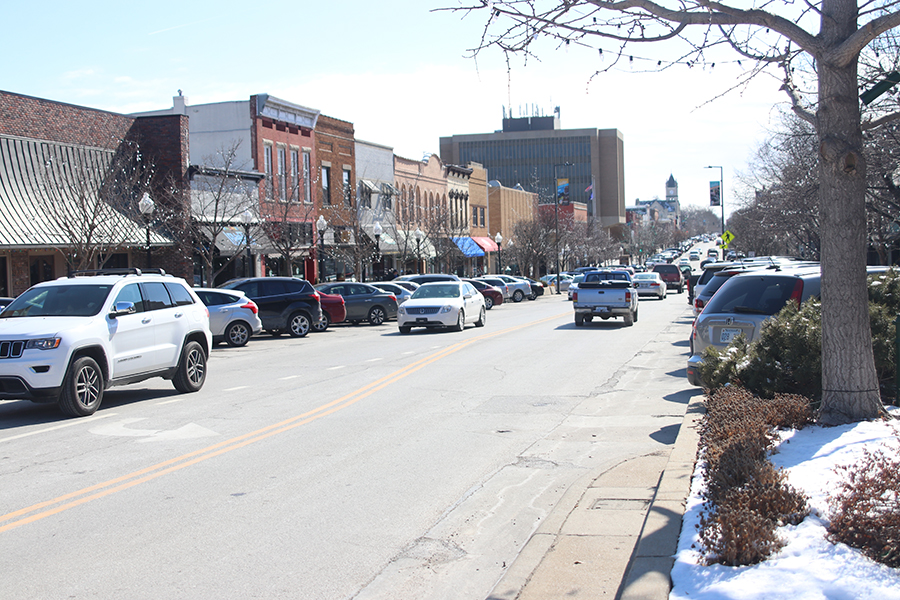 Massachusetts street in Lawrence Kansas offers a variety of shops and restaurants such as Love Garden Sounds and The Burger Stand.