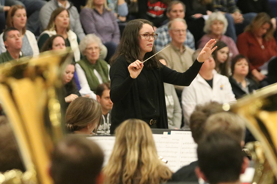 Conducting the second group of performers, band teacher Deb Steiner prepares to finish up the song.