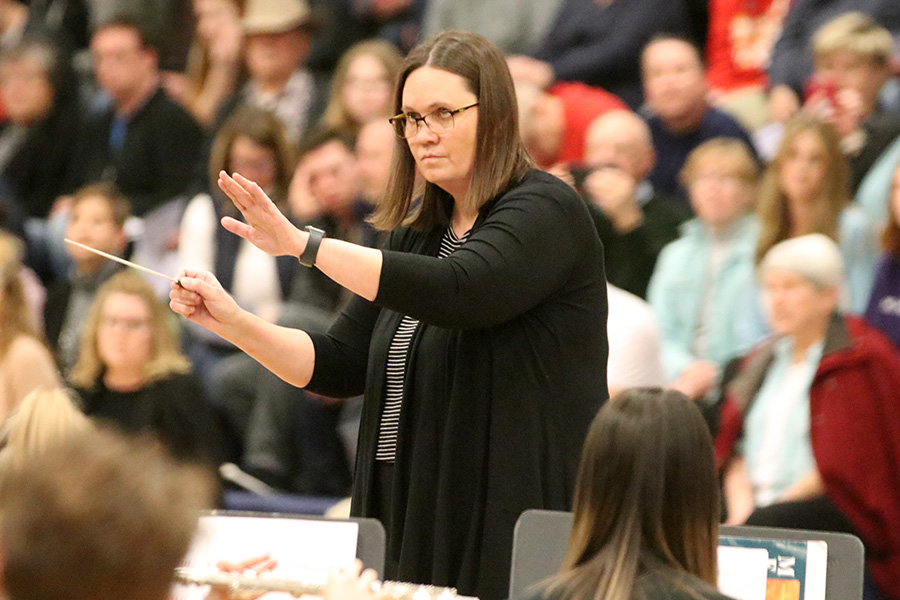 Conducting the first group of performers, band teacher Renee Huey keeps the rest of the performers on track.