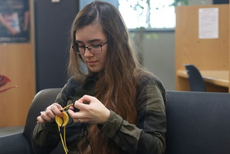 Sitting in the library, senior Joan Downey crochets a bumblebee. She will be selling them during Relay for Life as a way to raise money. Last semester she spent a lot of time crocheting in the library because she was the teacher assistant for Mr. Shelley.