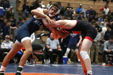 During the regional tournament on Saturday, Feb. 22, senior Zach Keal wrestles with his opponent. Keal went on to take first place in the 132-pound weight class.