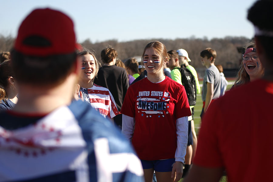 Smiling, junior Ellie Boone introduces herself to her team.