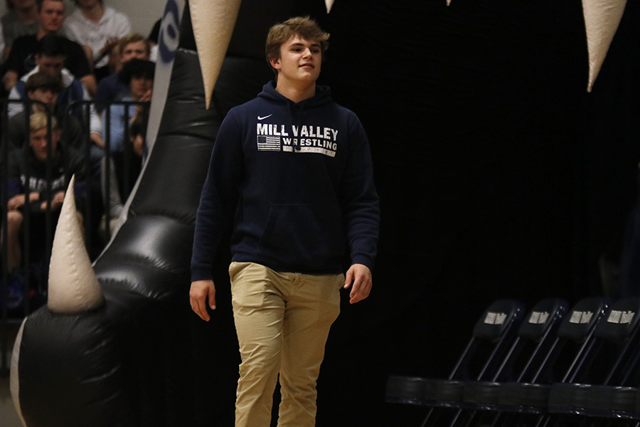 Walking out of the inflatable jaguar junior Dalton Harvey heads to his seat after assembly host Mick Shaffer announces his name.