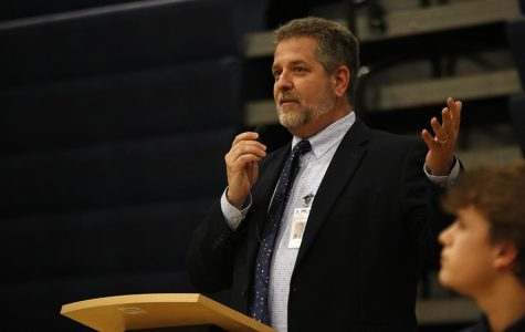 Frank Harwood addresses students at a pep assembly. Harwood outlined the district's Coming Back Together plan for school reopenings at the board meeting Monday, July 13.