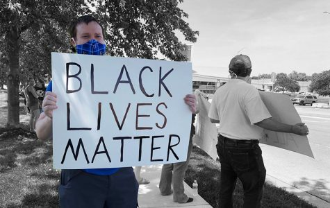 In light of the Black Lives Matter movement, Shawnee community members gathered at Monticello Library Sunday, June 14 to protest against police brutality. Nearly 100 civilians participated in the protest, holding up signs and shouting chants to cars passing by.