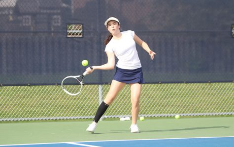 Hitting a forehand, junior Eden Schanker hits the ball to her opponent. She competed in doubles and singles Tuesday, Sept. 15 against Olathe South.