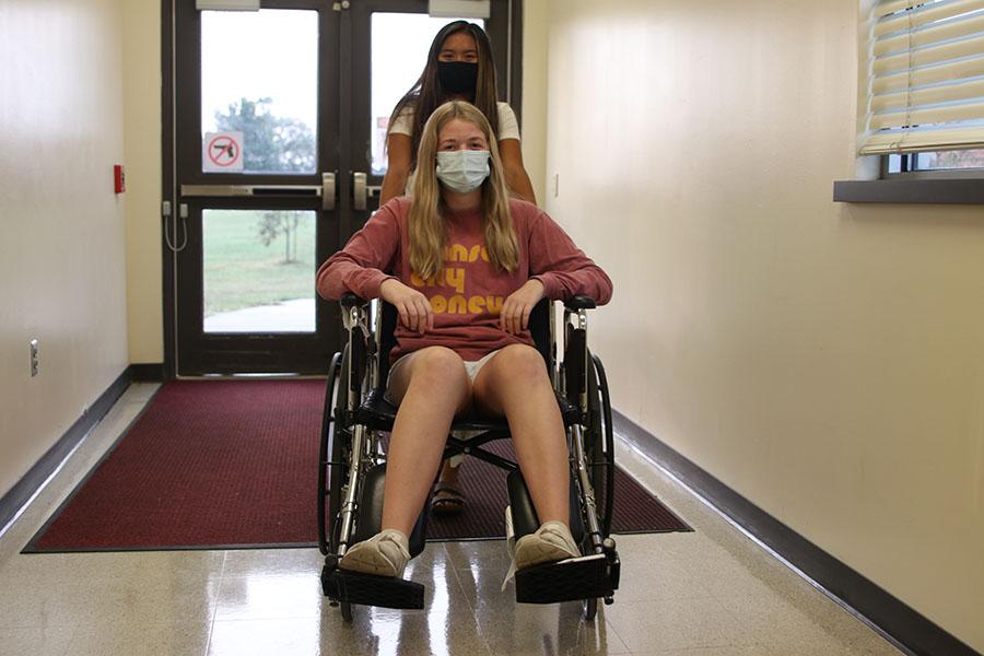 Pushing+junior+Kelly+Doyle+in+the+wheelchair%2C+junior+Jada+Eggleston+practices+wheelchair+use.+