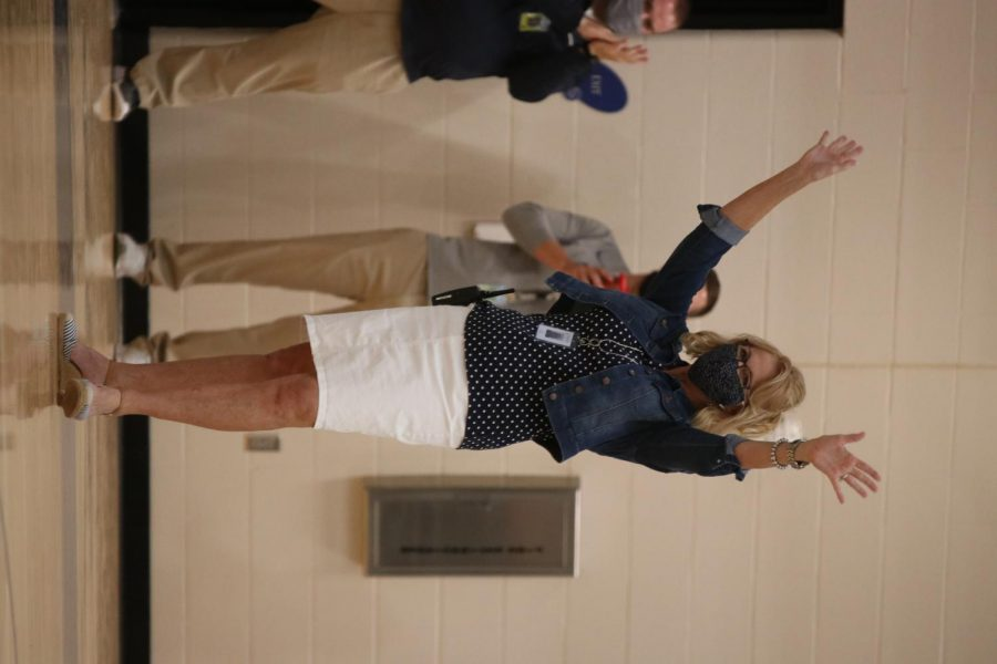In her first official introduction to the freshmen, Principal Dr. Gail Holder holds up her arms while receiving a round of applause.