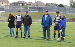 The varsity seniors were recognized at senior night on Thursday, Sept. 10. The boys walked down the field with coach Arlan Vomhof to stand with their parents on the edge of the field.