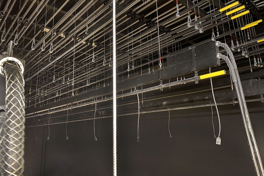 Behind the curtains, one can see all the pulleys that allow the theater team have more curtain options.