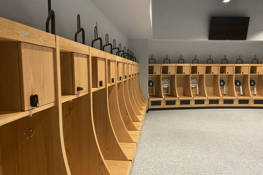 In the new field house, the varsity football locker room is very open so the coaches can easily speak to the entire team.