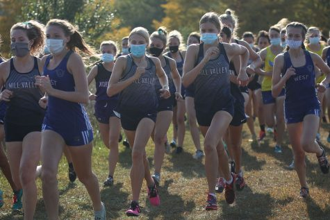 Side by side, juniors Bridget Roy and Katie Schwartzkopf begin the race with their masks on.