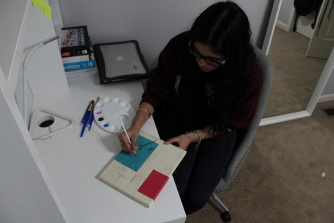 Starting by painting an outline, senior Navi Kaur enjoys creating another piece of artwork Wednesday, Oct 7.