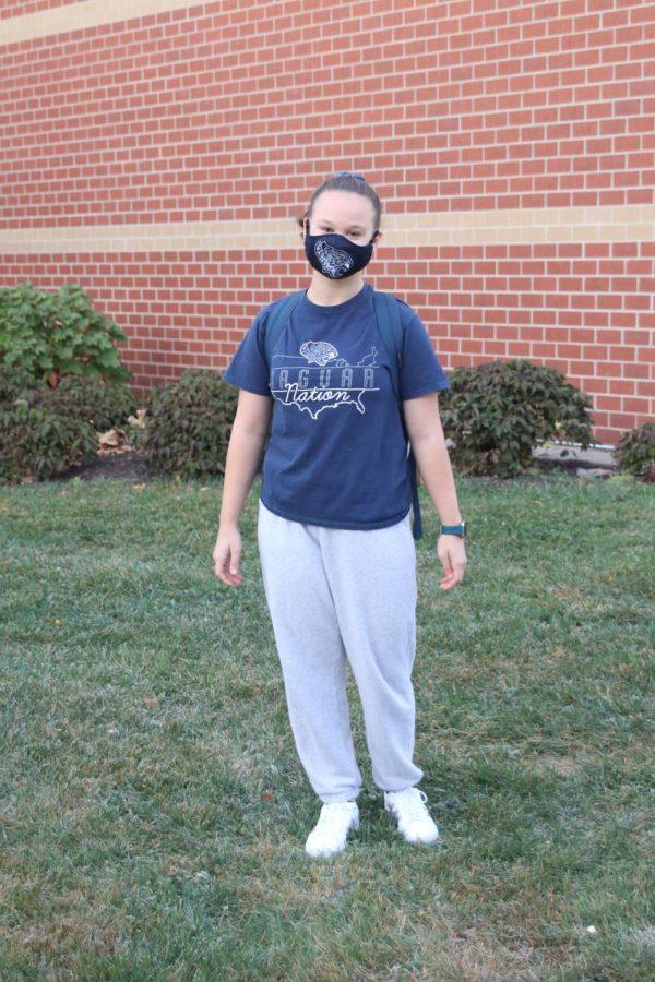 Ready to show some school spirit is sophomore Cassandra Frias in her jaguar nation shirt and jaguar mask.