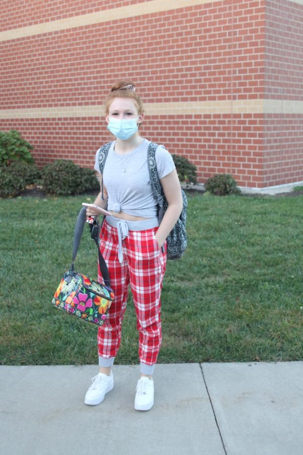 Standing at the entrance of Mill Valley, junior Audrey Zade smiles in her comfy PJ pants.