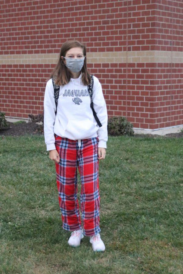 In her plaid PJs is freshman Kate Helm.