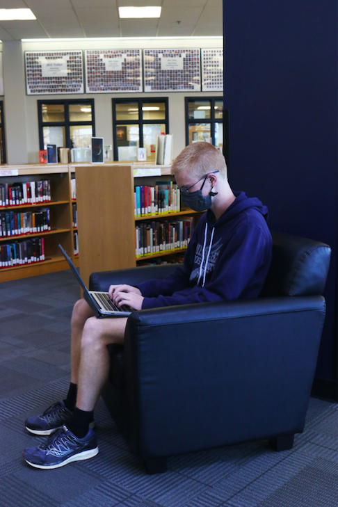 While proofreading the essay section of his application, senior John Lehan makes notes and leaves edits on his first draft of his essay on Monday, Oct. 12.