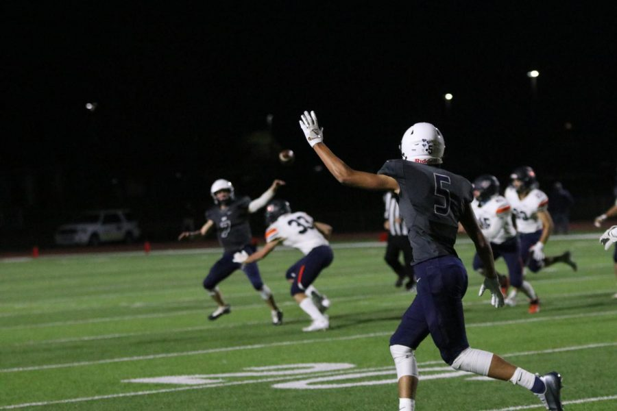 To help out quarterback Cooper Marsh, wide receiver Kendrick Jones puts his hand in the air to show he is open for the pass.