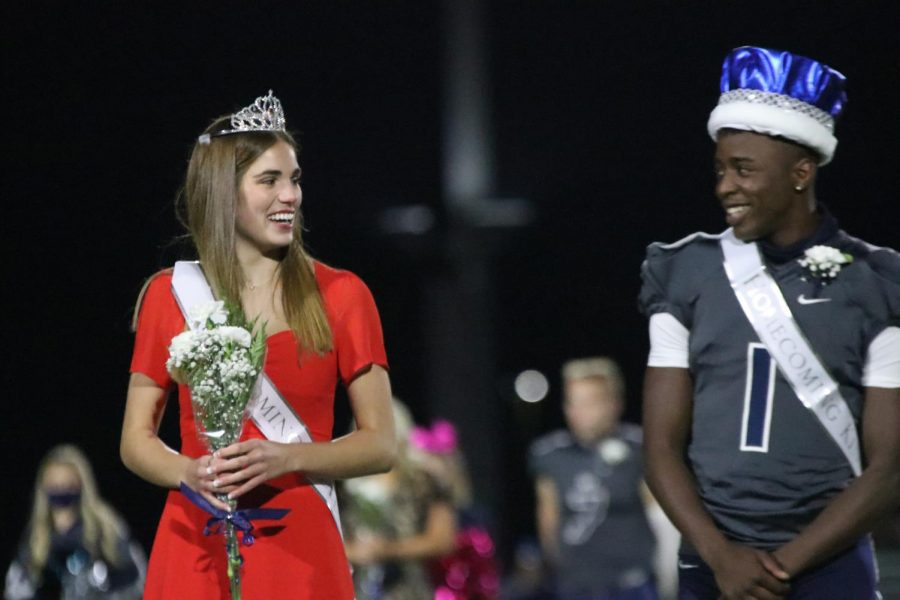 After being announced king and queen, Ellie Boone and Quin Wittenauer smile at their new title.