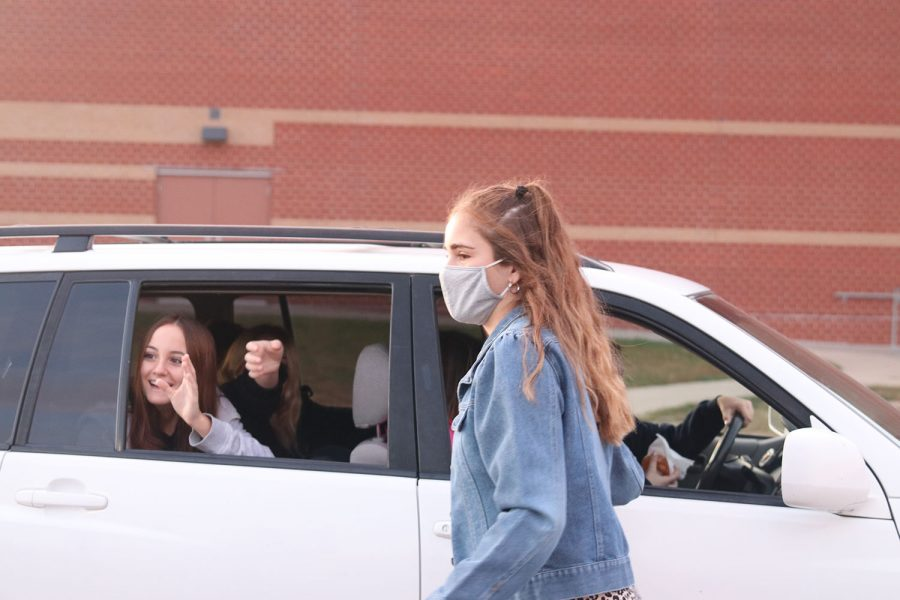 A car full of students drives away excited to start their morning off right with donuts.