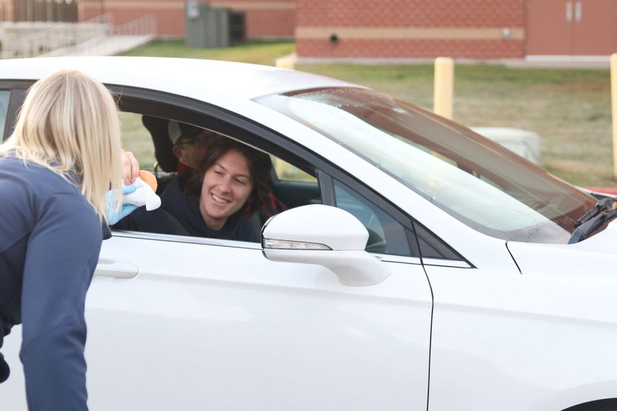Senior Davis Mason pulls up to school with his dad to get some breakfast.