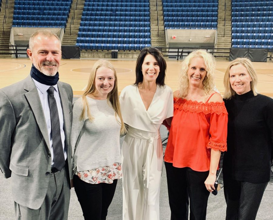 With smiles on their faces, athletic director Jerald VanRheen, math teacher Sarah Heffernon, PE teacher Debbie Fay, PE teacher Christine Preston and Assistant Principal Marilyn Chrisler stand for a photo after Fay was awarded into the Hall of Fame on Sunday, Nov. 15.