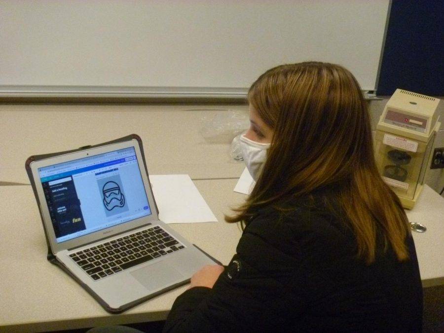 New robotics recruit freshman Ashlyn Bellmyer practices using Canva to make fundraising posters for the marketing team Thursday, Nov. 19