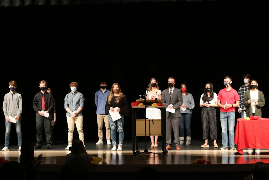 After all members lighted their candles, the newest inductees stood together on the stage to be recognized.