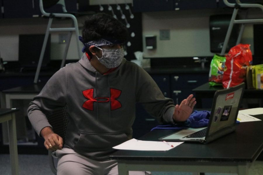 Freezing in place, senior Manoj Turaga stares at his screen focusing on solving the problem.