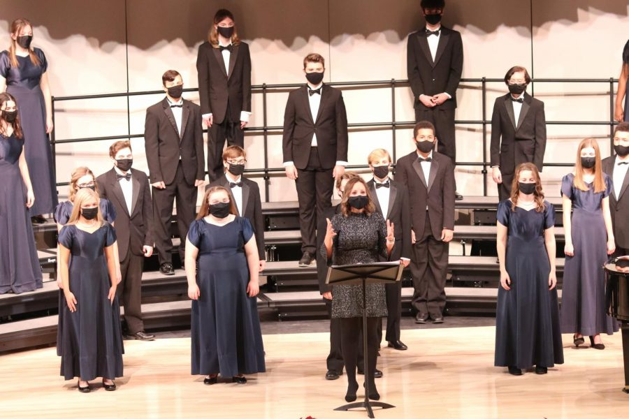 Choir teacher Jessie Reimer opens the winter concert with a speech directed to livestream viewers as well as her various choirs. Offering words of consolement and encouragement, she raises up spirits of those inside and outside the theatre that night.
