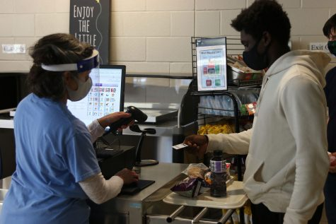 Rather than type in their lunch code, students were given lunch cards this year to help limit the spread of COVID. During lunch, freshman Nate Carter's lunch card is scanned on Monday, Nov. 16.