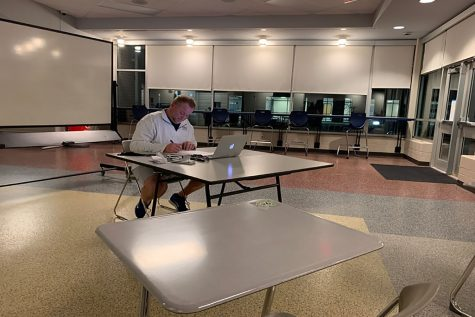 Ready to assist math teacher Kevin Mosher sits and waits for students to show up to his study hall on Monday, Dec. 7