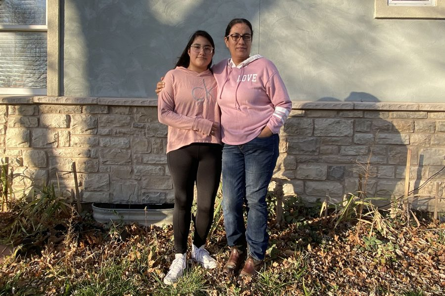 During their annual Christmas family tradition of making tamales for family and friends, sophomore Andrea Rios Rico stands beside her mother Rosalia Rico Rivera on Saturday, Nov. 10.