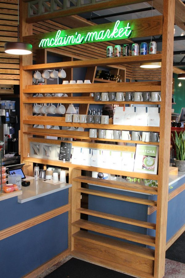 The McLain's Market shelf offers items such as mugs for customers to show their loyalty.