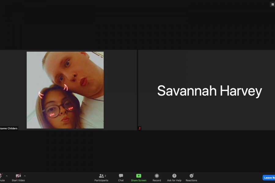 While being in a zoom call, Savannah Harvey sits with Shianne Childers with their cameras off during class.