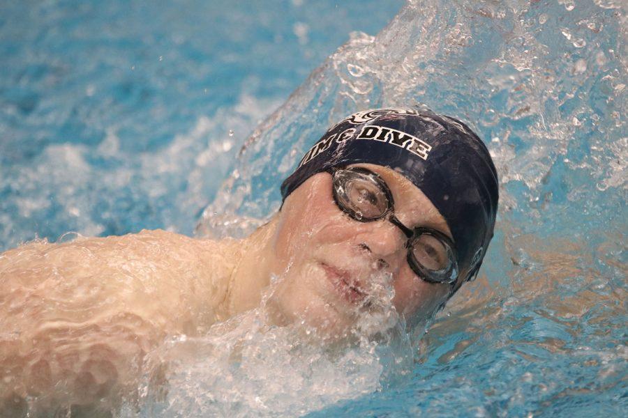 Breaking through the water, freshman Gabe Budimlija takes a breath while swimming freestyle.