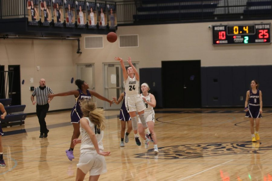 Just before the end of the first half, junior Emree Zars shoots the ball and makes a halfcourt shot.
