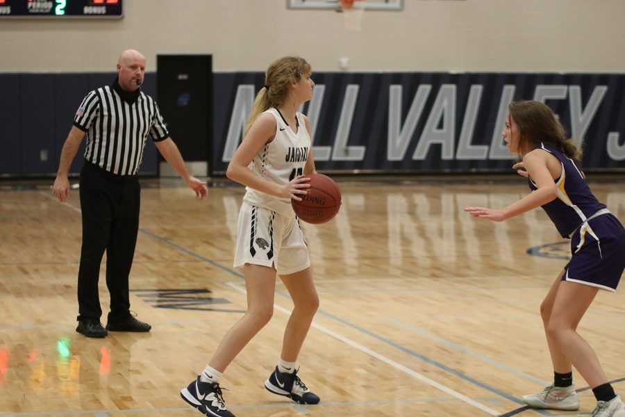 Taking a pause mid dribble, freshman Megan Kephart looks to pass the ball to a teammate.