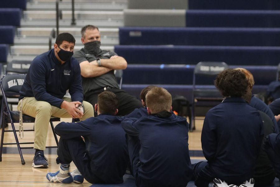 Before the meet begins, head wrestling coach Travis Keal speaks to his wrestlers about the meet.