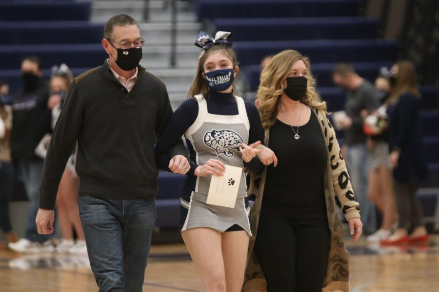 As she is announced senior Madison Jensen, walks onto the court.